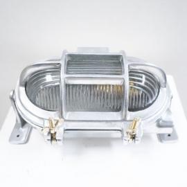 Lampe ovale en aluminium avec grille et vis en laiton