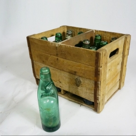 Wooden tray with soda bottles