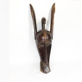 Masque de la société du Koré. Suku, Bambara, Malie. Bois à patine brune brillante par endroit