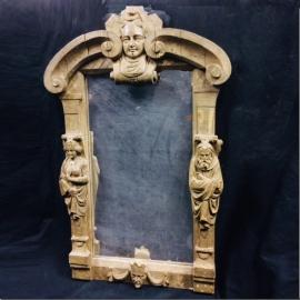 Miroir rectangulaire en bois stuck decor de mascarons XVIIIème S.